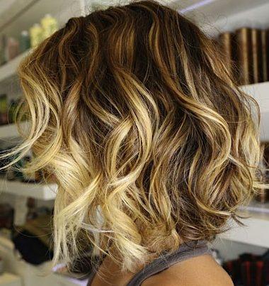 Blonde balayage hairstyle for wavy hair