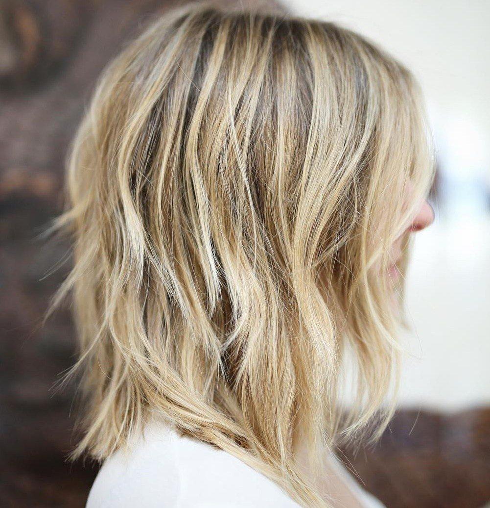 Layered shoulder length blonde hair
