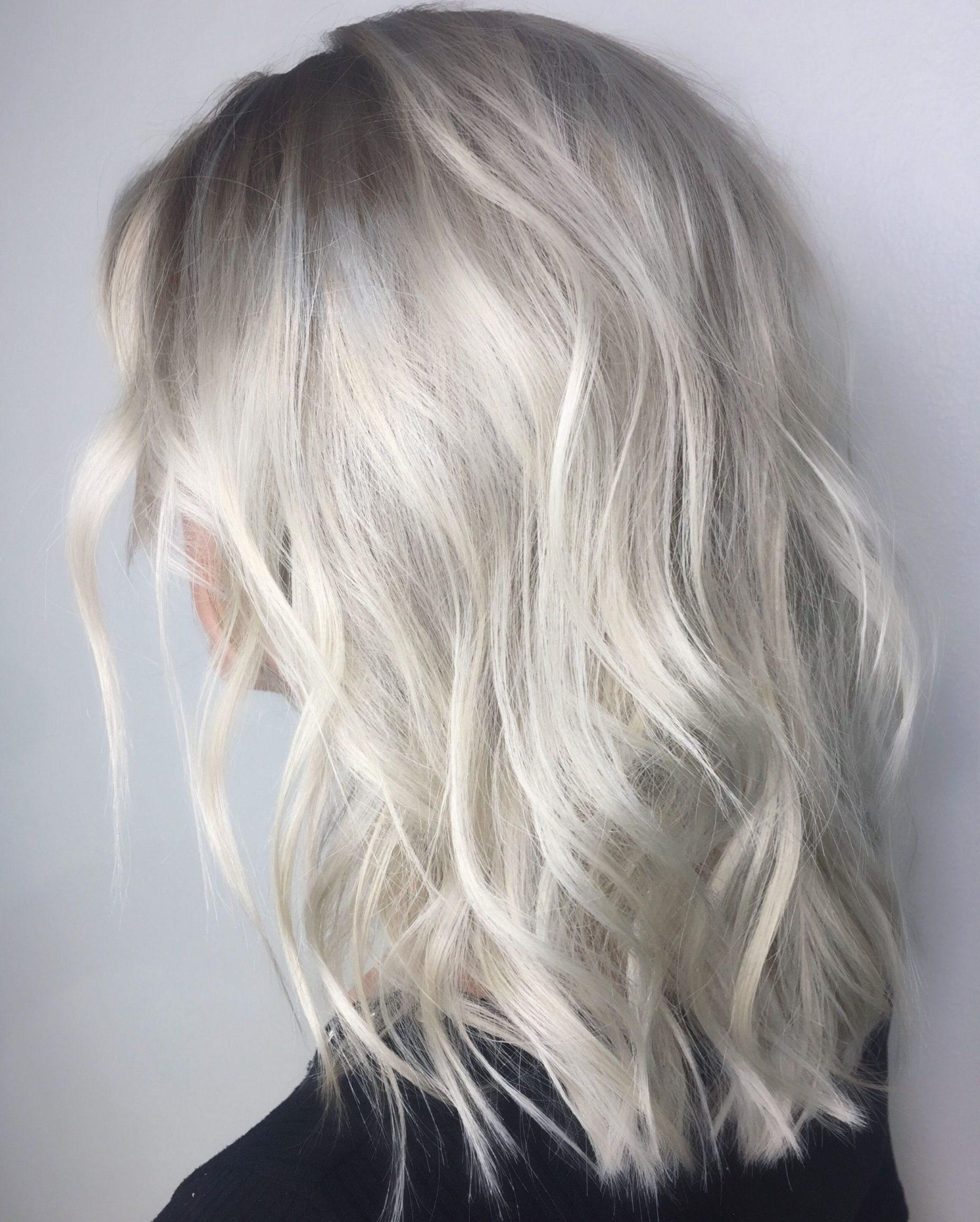 Short mid length platinum blonde hair