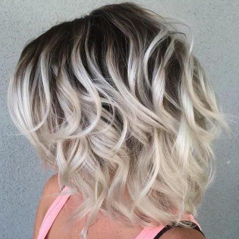 Short platinum hair with dark roots