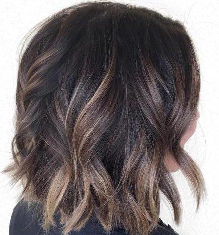 Sun kissed balayage on dark brown hair