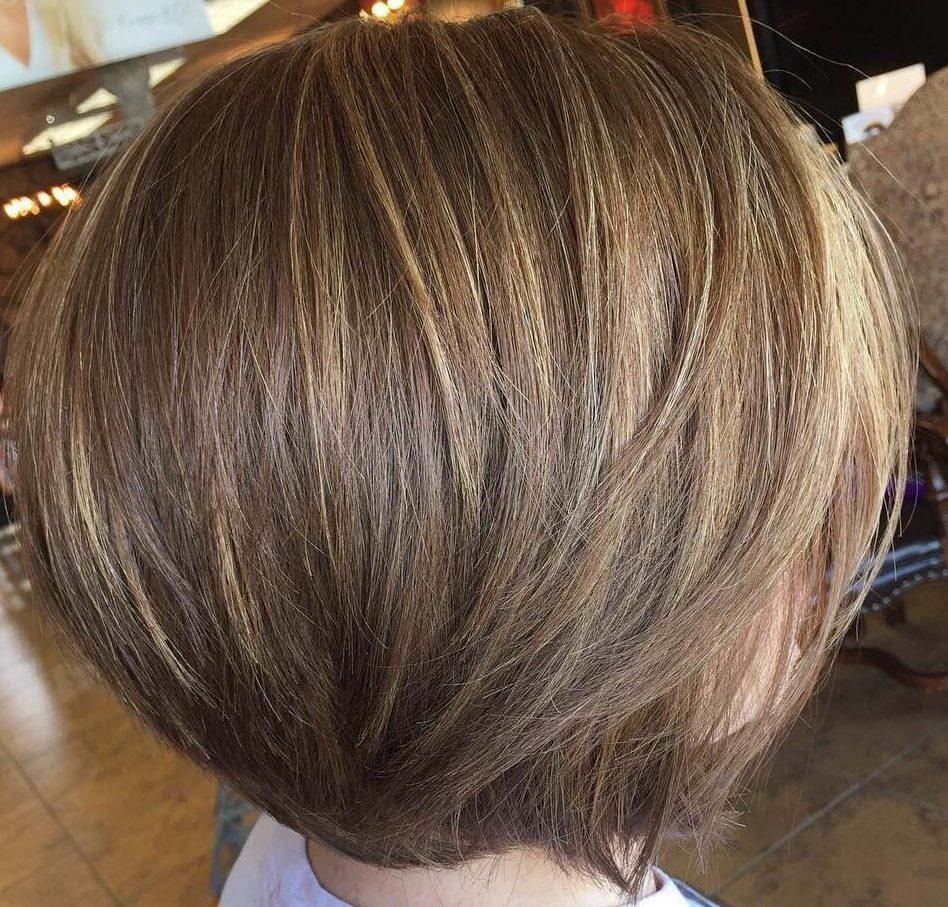 Sun kissed dark blonde hair with highlights for short hair