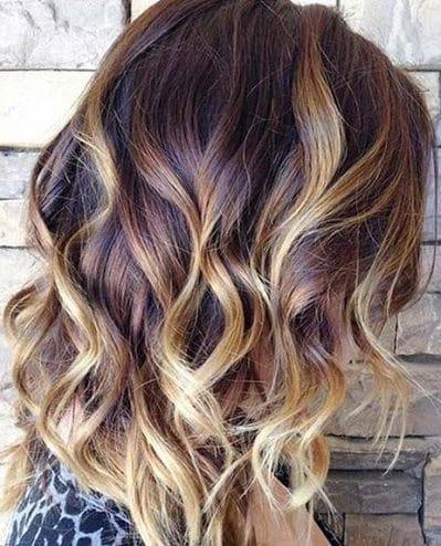 Shoulder length balayage short curly hair