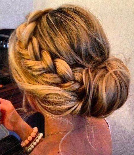 Messy side bun with braid